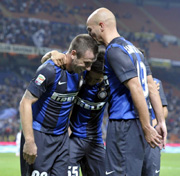 Cassano celebrates with teammates after a goal