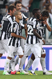 Pirlo celebrates with teammates after a goal