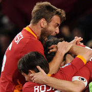 De Rossi Cassano celebrates with teammates after a goal